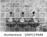 Small photo of Bathroom hotel amenity, shower gel, shampoo, and conditioner in luxury ceramics container with labels on steel shelf and tile wall in bathroom in hotel