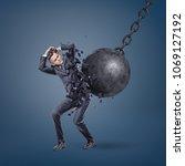 a giant wrecking ball hits a... | Shutterstock . vector #1069127192