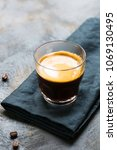 glass cup of fresh coffee with... | Shutterstock . vector #1069130495