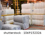 Small photo of Large white packages, bags with synthetic acrylic fiber in a warehouse at a petrochemical, refinery