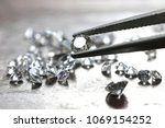 brilliant cut diamond held by... | Shutterstock . vector #1069154252