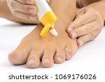 woman in foot care creams feet... | Shutterstock . vector #1069176026