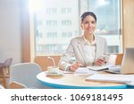 young smiling businesswoman in...   Shutterstock . vector #1069181495