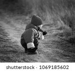 young happy boy playing outdoor ... | Shutterstock . vector #1069185602