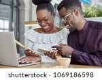 black woman and man have... | Shutterstock . vector #1069186598