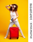 woman traveler with suitcase on ... | Shutterstock . vector #1069189598