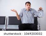 man nervously impatiently... | Shutterstock . vector #1069203032