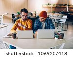 skilled young it professionals... | Shutterstock . vector #1069207418
