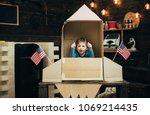 boy play with rocket  cosmonaut ...   Shutterstock . vector #1069214435