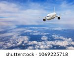 airplane flying above the...   Shutterstock . vector #1069225718