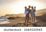 happy young family having fun... | Shutterstock . vector #1069233965