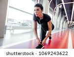 fit girl down to do shoelaces... | Shutterstock . vector #1069243622