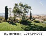 wooden chairs stand on green... | Shutterstock . vector #1069244078