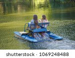 two girls ride on catamaran on... | Shutterstock . vector #1069248488