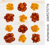 Small photo of Top view on Marigolds (Tagetes erecta, Mexican marigold, Aztec marigold, African marigold) on white wooden background.