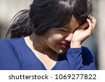 Small photo of Tearful Adult Female Woman