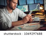 serious trader using mobile... | Shutterstock . vector #1069297688