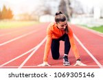 athlete woman at starting line | Shutterstock . vector #1069305146