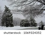 an early spring snow storm has... | Shutterstock . vector #1069324352