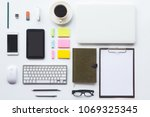 white desk office with laptop ... | Shutterstock . vector #1069325345