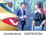 salesperson selling cars at car ... | Shutterstock . vector #1069345256