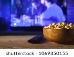 A wooden bowl of popcorn and...