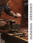 Man Works In Carpentry Workshop....