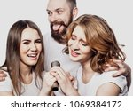 group of friends playing... | Shutterstock . vector #1069384172