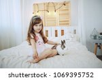little boy sitting at home on... | Shutterstock . vector #1069395752