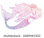 hand drawn mermaid swiming  on... | Shutterstock .eps vector #1069441322