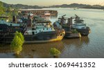 dockyard with tugboats on... | Shutterstock . vector #1069441352