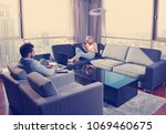 young couple relaxing at home... | Shutterstock . vector #1069460675