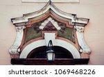 Small photo of Ornamentation above a building entrance with illuminati symbolic. Recorded in Poland.