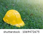 the yellow safety helmet put on ...   Shutterstock . vector #1069472675