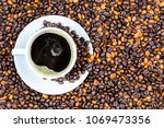 coffee cup and coffee beans on... | Shutterstock . vector #1069473356