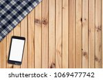 mock up mobile phone on empty... | Shutterstock . vector #1069477742