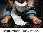 man suffers from diarrhea is... | Shutterstock . vector #1069491422