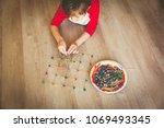 child making geometric shapes ... | Shutterstock . vector #1069493345