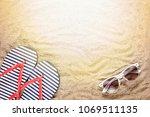 beach background. sunglasses ...   Shutterstock . vector #1069511135