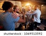 friends preventing fighting of... | Shutterstock . vector #1069513592