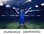 young asian footballer... | Shutterstock . vector #1069545452