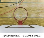 View from up through  basketball hoop, school sporting wooden board at the bottom  with a black line and kind of reflections. Basketball hoop in the sports hall closeup