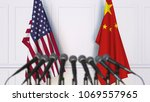 flags of the usa and china at... | Shutterstock . vector #1069557965
