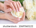 hands of a woman with beautiful ... | Shutterstock . vector #1069560122