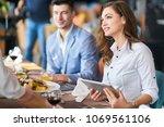 dinner after a buissnies... | Shutterstock . vector #1069561106