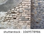stone wall streets of pompeii | Shutterstock . vector #1069578986
