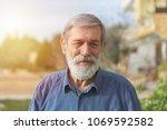 portrait of a senior man  | Shutterstock . vector #1069592582
