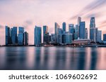 view of marina bay at sunset in ... | Shutterstock . vector #1069602692