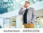 smiling bearded manager wearing ... | Shutterstock . vector #1069612256