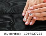 the manicure  pink with white... | Shutterstock . vector #1069627238